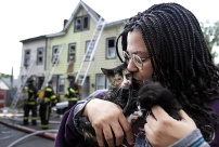 Sharon Phillips kisses Monkeyface, one of her 8 cats rescued from a house fire on Phillips Ave. in Trenton, NJ. Photo by David Gard/The Times of Trenton