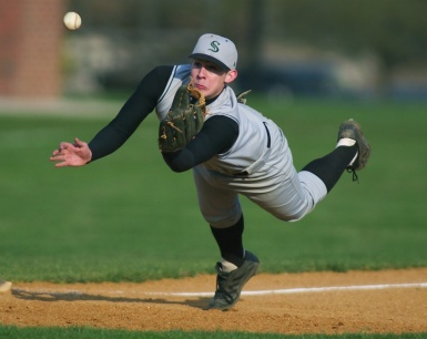 Steinert High School's Grant Harm makes a diving catch to end a game. Photo by David Gard/ The Times of Trenton