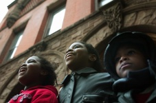 Zahara, ZhanŽ and Zavion Meadows watch as Trenton's Thanksgiving parade moves down East State St. Photo by David Gard/ The Times of Trenton