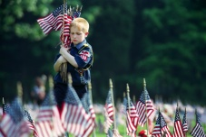 1000 boy, girl and cub scouts placed US flags on the 25,000 graves at the Brigadier General William C. Doyle Veterans Cemetery in Wrightstown in observance of Memorial Day. Photo by David Gard/ The Times of Trenton