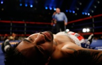 Gustavo Mejia of Kansas City, Mo., lies on the mat after his opponent Demetrio Soto of Los Angeles, Ca., knocked him out at 58 seconds in the first round of their Super Lightweights bout at Boardwalk Hall in Atlantic City, N.J. AP Photo/ David Gard