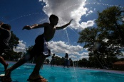 A boy runs through the fountain at Perth Amboy's Caledonia/Roessler Park. Photo by David Gard/ The Star-Ledger