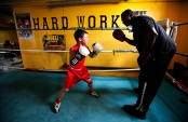An 8-year-old boxer trains in Newark, NJ. Photo by David Gard/ The Star-Ledger