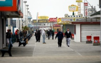 People walk on the boardwalk as Hurricane Sandy approaches Seaside Heights on Sunday, October 28, 2012. Photo by David Gard/The Star-Ledger