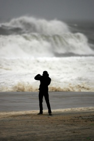 Wesam Allam, 20, of Seaside Heights, takes a photo of the pounding waves as Hurricane Sandy approaches Seaside Heights on Sunday evening, October 28, 2012. Photo by David Gard/The Star-Ledger