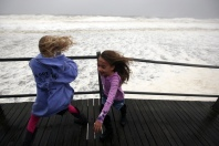 Sisters Jianna, 9, and Janna Lee, 7, Wroblewski, of Seaside Heights, take a last look at the ocean before they head for the relative safety of the mainland as Hurricane Sandy pounds the Seaside Heights Boardwalk on Monday, October 29, 2012. Photo by David Gard/The Star-Ledger