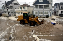 A front loader pushes sand and debris back toward the ocean on Harding Ave. in Lavallette. Hurricane Sandy pushed waves over the dunes on Harding Ave. Monday, October 29, 2012. The storm Photo by David Gard/The Star-Ledger