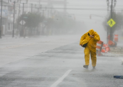 Edward Febus, 44, makes his way back to his house as Hurricane Sandy approaches Seaside Heights on Monday, October 29, 2012. He evacuated his wife and daughter yesterday and was planning to join them today. His car would not start, leaving him no escape from the storm and no choice but to ride it out. (Photo by David Gard/The Star-Ledger)