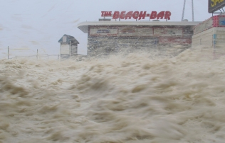 A wall of sea foam rushes down the boardwalk as Hurricane Sandy strikes Seaside Heights on Monday evening, October 29, 2012. (Photo by David Gard/The Star-Ledger)