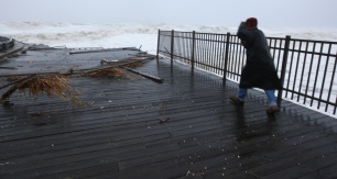 A man battles the wind as he looks at a destroyed section of the FunTown Pier as Hurricane Sandy strikes Seaside Heights on Monday evening, October 29, 2012. (Photo by David Gard/The Star-Ledger)