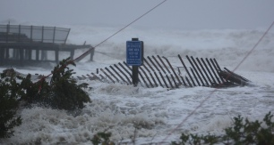 Waves surge over a dune as Hurricane Sandy strikes Seaside Heights on Monday evening, October 29, 2012. (Photo by David Gard/The Star-Ledger)