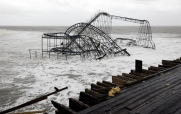 The Jet Star roller coaster from Casino Pier sits in the ocean in Seaside Heights the day after Hurricane Sandy landed. Tuesday, October 30, 2012. (Photo by David Gard/The Star-Ledger)
