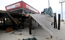 The Seaside Heights boardwalk is destroyed on the day after Hurricane Sandy landed. Tuesday, October 30, 2012. (Photo by David Gard/The Star-Ledger)