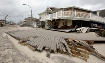 A section of the Seaside Heights boardwalk rests in the street on the day after Hurricane Sandy landed. Tuesday, October 30, 2012. (Photo by David Gard/The Star-Ledger)