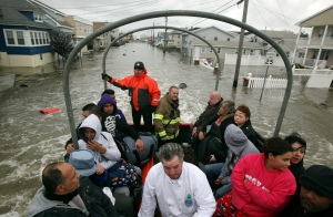 Residents evacuate Seaside Heights on an rescue vehicle the day after Hurricane Sandy landed. Tuesday, October 30, 2012. (Photo by David Gard/The Star-Ledger)