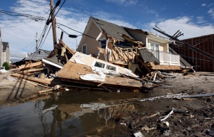 A destroyed house sits in the middle of Rt. 35 North in Ortley Beach on Wednesday, October 31, 2012. (Photo by David Gard/The Star-Ledger)