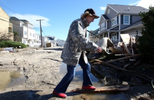 Amy Paynton of Seaside Heights surveys the destruction on Harding Ave. in Ortley Beach on Wednesday, October 31, 2012. (Photo by David Gard/The Star-Ledger)