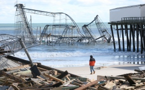 A man looks over the Jet Star roller coaster debris on the Seaside Heights beach near Casino Pier on Wednesday, October 31, 2012. (Photo by David Gard/The Star-Ledger)