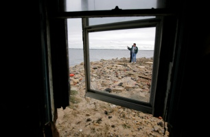 Jim and Robin Bedaro of Waretown look out at the Barnegat Bay. They came out to help the Becker's with their heavily damaged home on the bay. Thursday, November 01, 2012. (Photo by David Gard/The Star-Ledger)