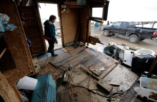 Merri Lee Becker, 66, walks through what was once her front porch. Her home in Bayville was heavily damaged. Thursday, November 01, 2012. (Photo by David Gard/The Star-Ledger)