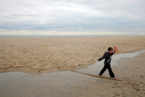 Will Goss, 7, of Point Pleasant Borough, walks across a plank on the Point Pleasant beach while holding onto a boardwalk prize he found. Thursday, November 01, 2012. (Photo by David Gard/The Star-Ledger)