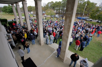 Hundreds line up at Berkeley Township Municipal Building to get stickers, allowing them access to their houses. Residents of South Seaside Park and Seaside Park where allowed back onto the Island today to retrieve items, clean-up and winterize homes ahead of the Nor'Easter. Monday, November 05, 2012. (Photo by David Gard/The Star-Ledger)