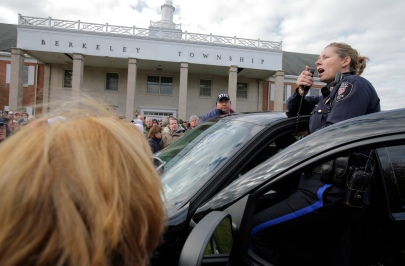 Berkeley Township Mayor Carmen F. Amato, Jr. and Chief of Police Karin DiMichele address hundreds of residents at town hall waiting to prove residency. Residents of South Seaside Park and Seaside Park where allowed back onto the Island today to retrieve items, clean-up and winterize homes ahead of the Nor'Easter. Monday, November 05, 2012. (Photo by David Gard/The Star-Ledger)