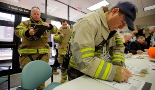 Ocean County officials are allowing Hurricane Sandy affected residents to vote early. Toms River Assistant Fire Chief Eddie Storino, right, probationary firefighter Matthew Duell and Safety Officer Philip Hann, left, stop during a shift to vote. Voting continues at the Ocean County Administration Building in Toms River. Monday, November 05, 2012. (Photo by David Gard/The Star-Ledger)